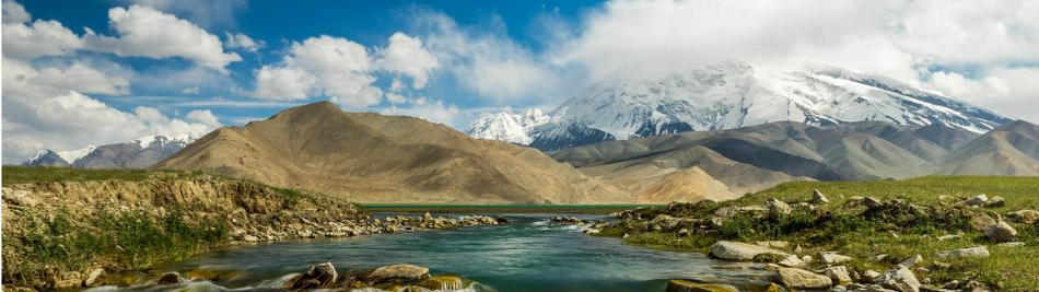 Hiking along the edge of Karakol Lake, on the Chinese side of the Karakoram Highway. -  Photo: Jarryd Salem